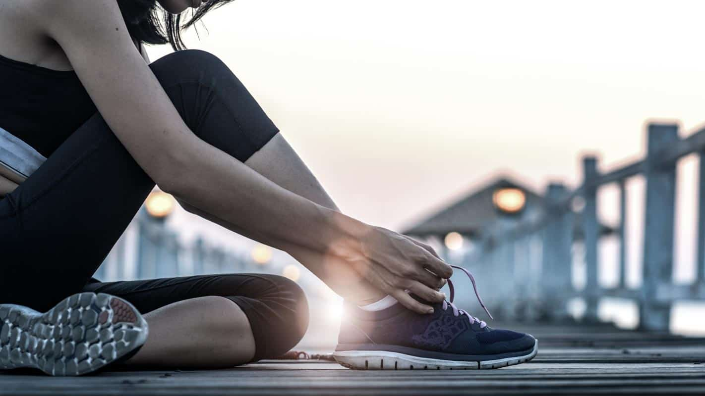 Physiotherapist-excercise-classes-in-Sydney-lady-doing-up-her-running-shoes